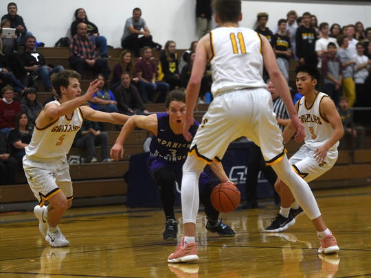 Spanish Springs' DJ Panfili (3) dribbles through the
