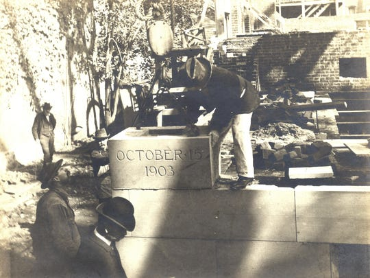 William Phelps lays a time capsule in the library's cornerstone in 1903.