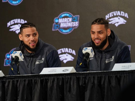 Nevada Wolf Pack forwards Caleb Martin (left) and Cody Martin (right) speak with media during practice at Philips Arena in Atlanta on Wednesday, March 21, 2018.