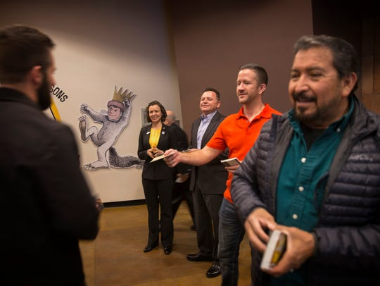 From right, Farmington City Council District 4 candidate Janis Jakino, Brandon Jakino, Allen Elmore and Hector Rangel greet community members on Tuesday before the start of a candidate forum hosted by Leadership San Juan at the Farmington Public Library.