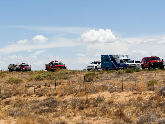 Emergency personnel from multiple agencies respond to the scene of a fatal vehicle collision Friday on Navajo Route 36 in Nenahnezad.