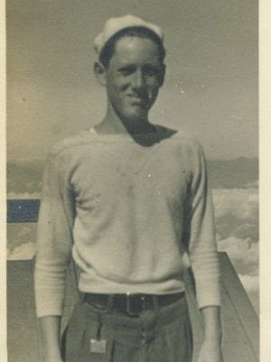 Dr. Ernest Carlson is pictured at the top of Mount Fuji in Japan as a teenager in the late 1930s.