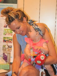 Stacy Peterson holds her daughter Eva, 6 months, during