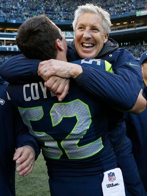January 18, 2015; Seattle, WA, USA; Seattle Seahawks middle linebacker Brock Coyle (52) celebrates with head coach Pete Carroll after the 28-22 victory against the Green Bay Packers in the NFC Championship game at CenturyLink Field.