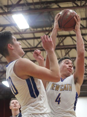 """Brennan Hall grabs a rebound in Newport Central Catholic's win over Lloyd in the Ninth Region All """"A"""" championship game."""