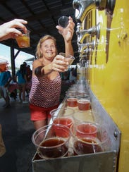 Julie Rives of Pendleton pours beer during the Brewery