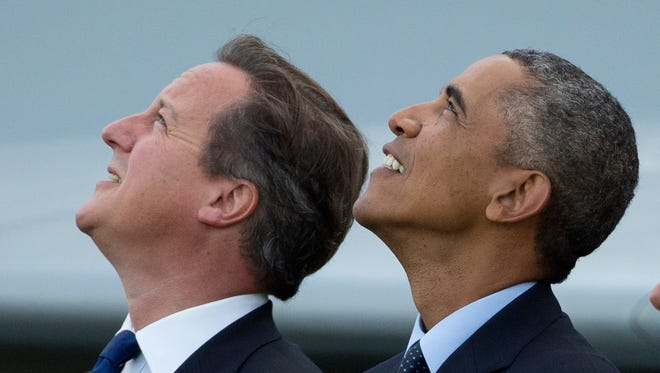 President  Obama and British Prime Minister David Cameron, left, watch a flypast on the second day of a NATO summit at the Celtic Manor Resort in Newport, Wales, in September 2014.