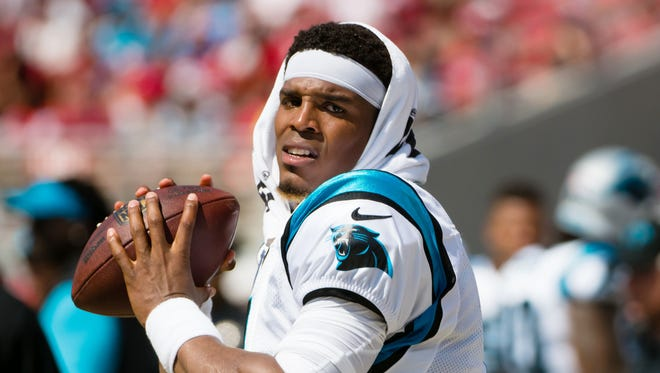 Carolina Panthers quarterback Cam Newton (1) warms up along the sideline during the first quarter against the San Francisco 49ers at Levi's Stadium.