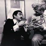Larry Ramirez (left) discusses a prototype trumpet with jazz star Maynard Ferguson in 1977. Ramirez, of Elkhorn, designed custom instruments for great musicians, including Ferguson.