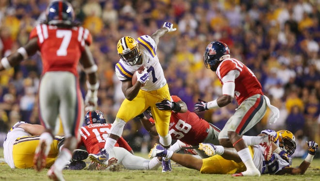 Ole Miss and LSU scored 17 points last season, but both teams' offenses could rule Saturday's game, including LSU running back Leonard Fournette (7).