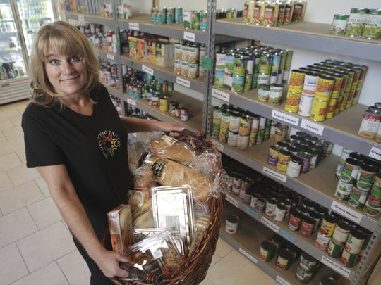Mason Food Pantry Director Gina Brown, pictured here