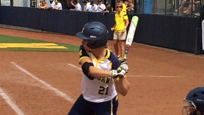 Michigan's Kelly Christner swings during Saturday's win over California in Ann Arbor.