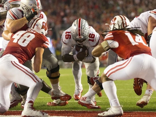No. 2 Ohio State squeaked past Wisconsin.