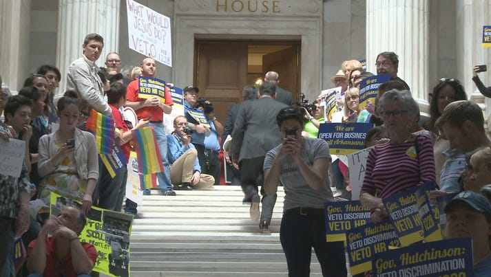protesters on stairs in Capitol