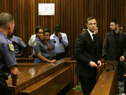 South African athlete Oscar Pistorius after his sentencing at the high court in Pretoria, on October 21, 2014.  Pistorius was sentenced by Judge Thokozile Masipa to up to five years in jail for the shooting and killing of his girlfriend Reeva Steenkamp on Valentine's Day 2013 at his home in South Africa.