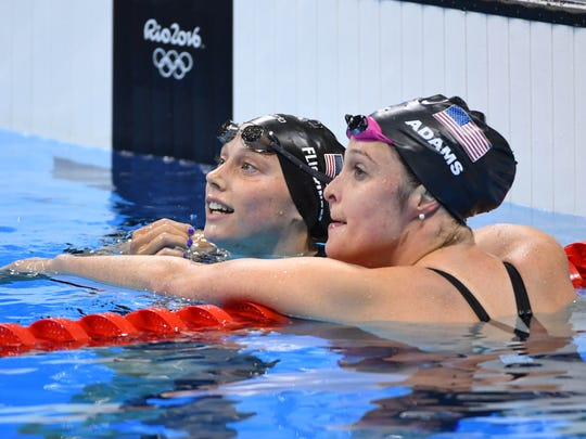 Hali Flickinger, left, greets Cammille Adams (USA) after the women's 200-meter butterfly final in the Rio 2016 Summer Olympic Games at Olympic Aquatics Stadium. Flickinger placed seventh in the event.