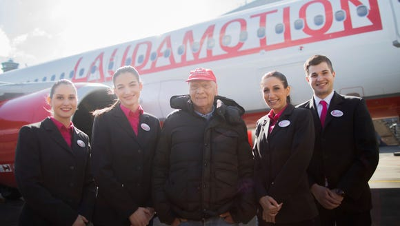 Niki Lauda (center), the former F1-driver who helped