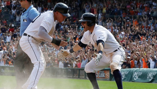 Detroit Tigers rookie JaCoby Jones, left, is greeted by teammate Ian Kinsler after scoring the winning run during the ninth inning against the Chicago White Sox on Wednesday, Aug. 31, 2016, in Detroit. The Tigers won, 3-2.
