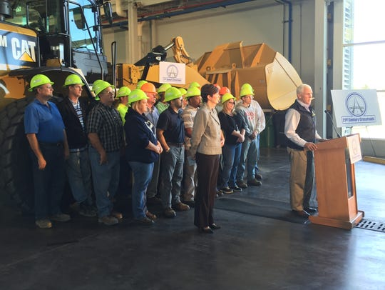 INDOT workers pose behind Gov. Mike Pence Tuesday,