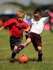 Bandits player Charlie Longhofer (left) tries to steal the ball away from a Legacy player during the 3v3 Live soccer tournament June 17 at the Lee Athletic Complex.
