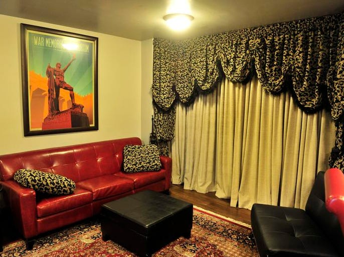 The red couch in the Belle Kinney Room came from Porter Wagoner's Music Row studio.