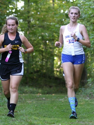 Zane Trace's Hailey Puckett (right) competes in the Down on the Farm XC Meet earlier this season. During the meet, Puckett provided an act of kindness that didn't go unnoticed.