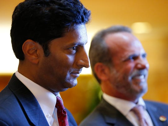 In this Monday, June 5, 2017 file photo, Suresh Chawla, left, of Chawla Hotels and Eric Danziger, CEO of Trump Hotels, are shown in New York, at a launch event for four new Trump hotels being built in Mississippi. Chawla Hotels, a Mississippi developer that has joined with the Trump Organization to open the first of possibly dozens of hotels in the U.S. president's new mid-priced chain, has applied for millions of dollars of state tax breaks.