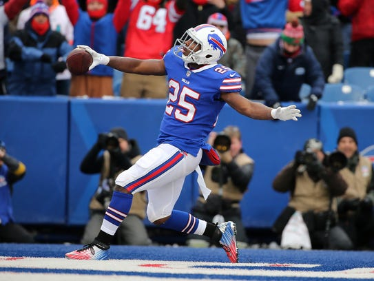 Bills running back LeSean McCoy scores one of his two