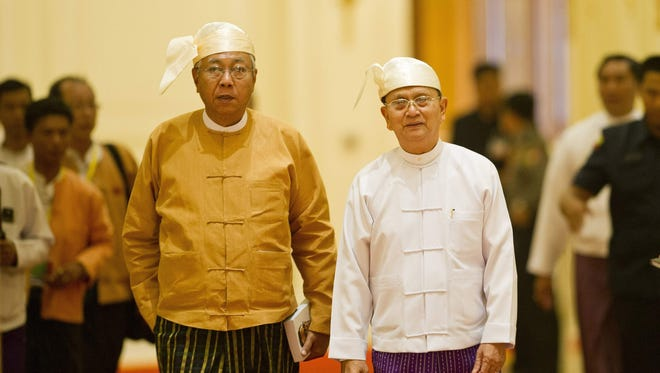 New Myanmar President Htin Kyaw (left) and outgoing president Thein Sein arrive for the  handover ceremony at the presidential palace in Naypyidaw on March 30, 2016.