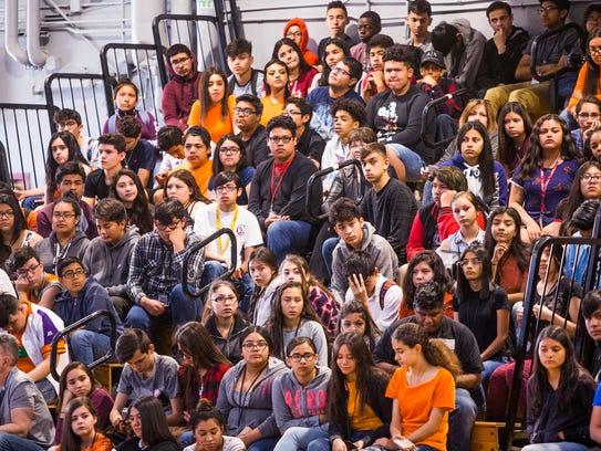 Students listen to Alfonso Calderon, 16, a junior at