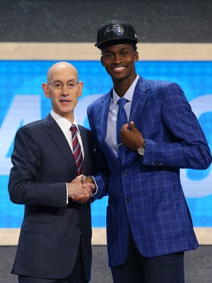 Jun 22, 2017; Brooklyn, NY, USA; Jonathan Isaac (Florida State) is introduced by NBA commissioner Adam Silver as the number six overall pick to the Orlando Magic in the first round of the 2017 NBA Draft at Barclays Center. Mandatory Credit: Brad Penner-USA TODAY Sports