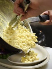 Cook Andrew Yunker adds a side of macaroni and cheese