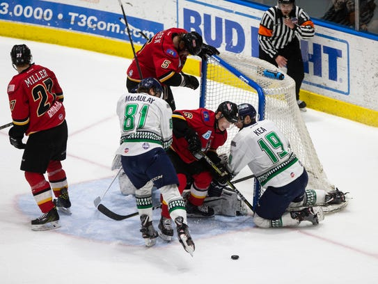 Florida Everblades forwards Justin Kea and Stephen MacAulay attempt to score against the Adirondack Thunder defense during Game 2 of the Eastern Conference Finals at Germain Arena on Saturday, May 12, 2018.