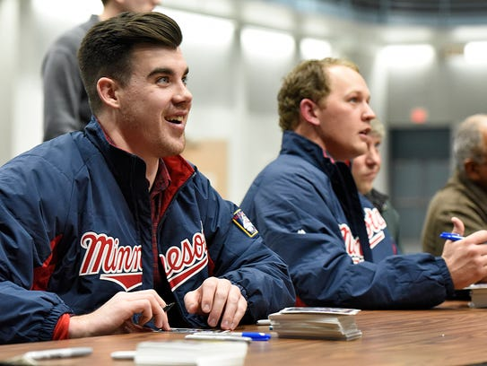 Twins players Trevor May and Tyler Duffey sign autographs