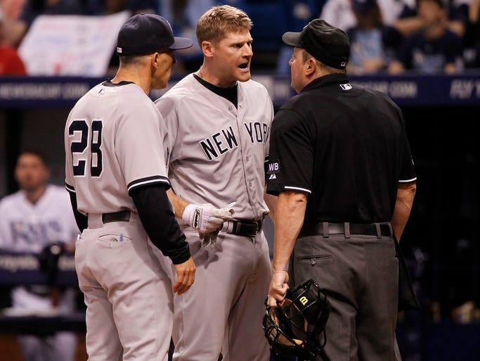 Sept. 15:  Yankees third baseman Chase Headley (12) reacts to umpire Marty Foster after he was ejected for arguing balls and strikes during the seventh inning against the Tampa Bay Rays at Tropicana Field.
