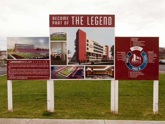 A sign on Dixie State University's campus touts the Legend Solar stadium.