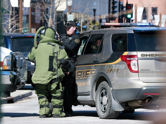 A bomb squad gets help put on his suit at The 400 Block Wednesday, March 14, 2018, in downtown Wausau, Wis.