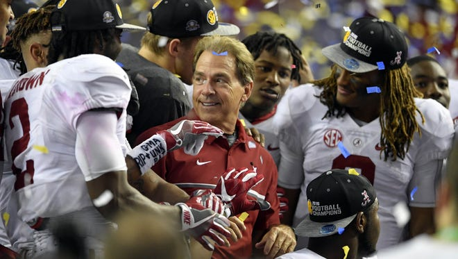 Nick Saban and his team celebrates a win in the SEC title game.