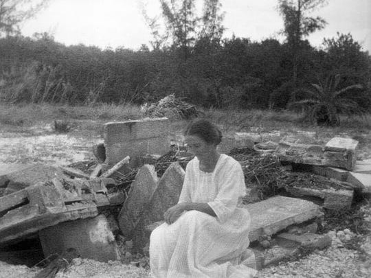 Emma Teed at brother's grave site, destroyed in a hurricane