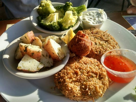 Chuck''s Seafood  has been a landmark since the 1960s. It has great food, a lot of seating, inside and outside, and a patio where there are breathtaking sunset views. Pictured is  coconut-crusted grouper cakes with sweet Thai chili sauce and sides of red skinned potatoes and broccoli.