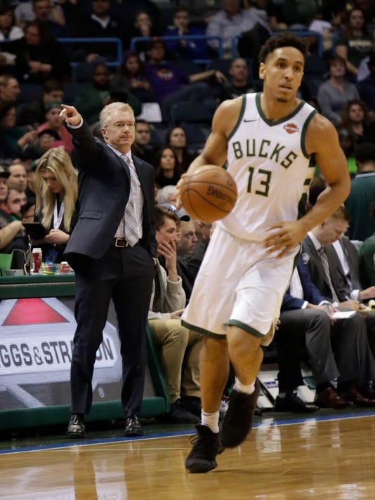 Milwaukee Bucks new interim manager Joe Prunty, left, calls to his team as they take on the Phoenix Suns during the first half of an NBA basketball game Monday, Jan. 22, 2018, in Milwaukee. (AP Photo/Darren Hauck)