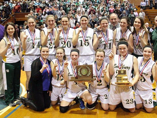 Members of the Enosburg girls baseketball team pose with the trophy after their 52-37 win over Thetford in the Division III high school girls basketball championship game at Barre Auditorium on Saturday.
