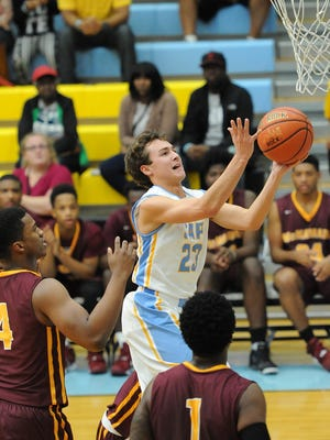 Capes Drew Mulcahy drives for 2 points as Cape Henlopen played Bishop McNamara in the Slam Dunk to the Beach held at Cape Henlopen High School.