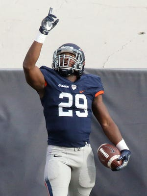 UTEP running back Aaron Jones looks up to the heavens after scoring a touchdown against the University of North Texas on Nov. 26 in Sun Bowl Stadium.