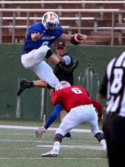 Guthrie's Landon Roberts leaps over a tackle attempt
