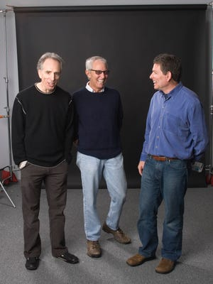 Milwaukee-area natives Jerry Zucker (from left), Jim Abrahams and David Zucker take a minute in this 2014 photo, when the trio were the focus of a tribute at the Milwaukee Film Festival.