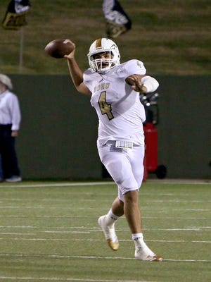 Rider quarterback Jorge Vargas launches a pass after being forced out of the pocket against Wichita Falls High on Oct. 6 at Memorial Stadium.