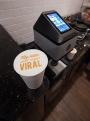Mug & Spoon in Rehoboth Beach has a new coffee machine that prints edible photos on the top of lattes that they are calling social lattes.