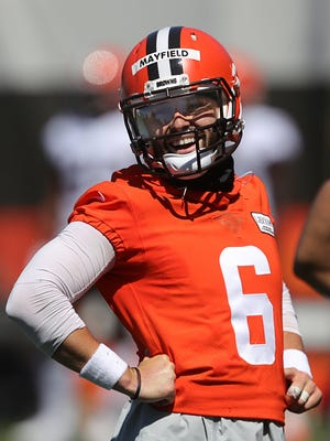 Cleveland Browns quarterback Baker Mayfield (6) laughs during practice at the NFL team's training facility, Thursday, Aug. 20, 2020, in Berea, Ohio.
