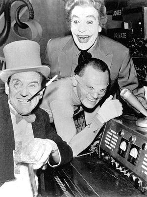 Frank Gorshin (center), who played the 'Riddler' on the Batman TV series, is seen with Cesar Romero (top) as the Joker and Burgess Meredith as the Penguin. Gorshin's son, Mitch, has opened Gorshin Trading Post & Supplies in Haddonfield.